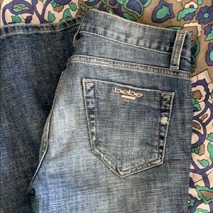 Bebe low-rise soft jeans. Flare leg. 27